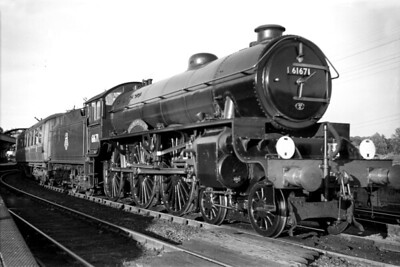 Thompson B2 class 4-6-0 no. 61671 Royal Sovereign in charge of a Down service at Sudbury (Suffolk). 61671 started its LNER career as a Gresley B17/4 'Sandringham' class 3-cylinder locomotive built by Robert Stephenson & Hawthorn Ltd. entering service on 11/6/1937. In 1945, 61671 was rebuilt under Thompson's auspices as a 2-cylinder machine with a 100A boiler and, along with 9 more B17's, was reclassified as B2. 61671 was always allocated to Cambridge and would be withdrawn there on 22/9/58. [Mike Morant collection]