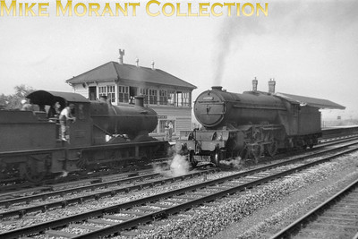 Gresley V2 class 2-6-2 no. 60879 runs light past an unidentified Collett 2251 class 0-6-0 at Denham on the GW & GC Joint. [Mike Morant collection]