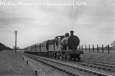 M&GNJR 'C' class 4-4-0 no. 53 at Thursgood whilst in charge of the 2.38 p.m. South Lynn to Norwich passenger service on 4/7/1936. No. 53 was built by Sharp Stewart in August 1896 and would be withdrawn as LNER no. 053 in January 1940 classified by the LNER as a D52. [H. C. Casserley / Mike Morant collection]