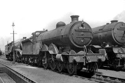 Former GNR, Ivatt C1 class atlantic no. 62822 at its home shed of 35B Grantham on June 4th, 1950. This was the one of only two C1's to see service with its BR number applied. It had been applied in the preceding February but the loco is already looking decidedly careworn in this shot taken only four months thereafter. 62822 would be withdrawn from service on November 27th of the same year. In stark contrast is immaculate Gresley A4 pacific no. 60026 Miles Beevor in blue livery behind 62822. [Mike Morant collection]