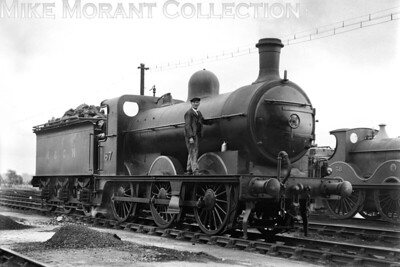 M&GNJR 'DA rebuild' class 0-6-0 no. 87 on shed at South Lynn on 28/6/1929. No. 87 was built by Dübs & Co. in October 1900 to the same design as the then GNR 'J4' class but was rebuilt in May 1925 with the larger boiler as shown here. No. 87 was something of a survivor passing into LNER stock and classified as a 'J4' in 1937. The good fortune mcontinued with renumbering by the LNER in 1946 to 4162. Although allocated a BR number it was never applied and withdrawal came at Retford mpd in August 1948. [H. C. Casserley / Mike Morant collection]