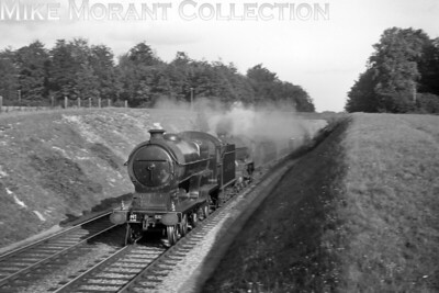 LNER, former GCR Robinson D11/1 'Large Director' 4-4-0 no. 5507 Gerard Powys Dewhurst piloting Gresley B17 'Footballer' class 4-6-0 no. 2855 Middlesbrough in charge of a Down express from Marylebone passing through Dutchlands, Little Missendedn, on 3/9/1938. Although the train's Marylebone departure time isn't stated, the sleeve note does tell us that the picture was taken at 4.55 and that it was a Saturday. [S. H. Freese / Mike Morant collection]