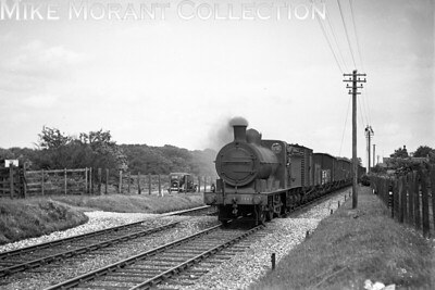 M&GNJR 'DA rebuild' class 0-6-0 no. 86 on freight duty at Thursford on 4/7/1936. No. 86 was built by Dübs & Co. in October 1900 to the same design as the then GNR 'J4' class but was rebuilt in October 1927 with the larger boiler as shown here. No. 86 was something of a survivor passing into LNER stock and classified as a 'J4' in 1937. The good fortune continued with renumbering by the LNER in 1946 to 4161 but withdrawal came at South Lynn mpd in September 1947. [H. C. Casserley / Mike Morant collection]