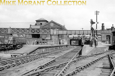 The former GER Millwall Junction station looking eastwards towards Blackwall whilst the branch to the right is for Millwall Doick and North Greenwich. Millwall Junction station, shown here on May 5th 1956, closed to passengers on 4/5/1926 and to goods traffic on 14/11/1927 (Ref Disused Stations web site). The Docklands Light Railway now runs through the site. [Mike Morant collection]