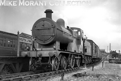 M&GNJR 'C' class 4-4-0 no. 54 at South Lynn station on 4/7/1936. No. 54 was built by Sharp Stewart in September 1896 and would be withdrawn as LNER no. 054 in October 1939 classified by the LNER as a D52. [H. C. Casserley / Mike Morant collection]
