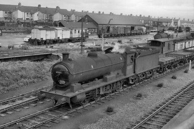 Former NER, raven Q6 class 0-8-0 no. 63357 shunts at Tyne Dock goods yard on an unspecified date in 1963. Note the locomotive turntable at the left of the shot. 63357 was a Consett allocated loco from 1943 until withdrawal in May 1965. [H. C. Casserley / Mike Morant collection]