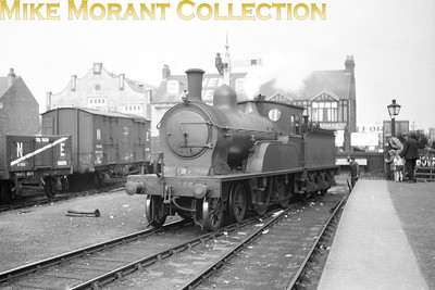 LNER orsdell deigned D20 class 4-4-0 no. 356 is in the process of running round its train having just been turnd onthe cramped turntable a Withernsea station on 19/8/1929. This loco was a NER 'R' class and most would survive into the BR era but 356 was withdrawn in September 1946 following a collision at Harrogate. Withernsea station closed to passenger traffic on 19/10/64 and to all other traffic on 3/5/65. The long wheelbase wagon is an NER ' road van' which was used to transport a number of small items, each consignment insufficient to warrant a van or wagon of its own. So, essentially a goods van to be attatched to a pick-up goods train.Overall length over buffers was 30', wheelbase 15'. [Mike Morant collection]