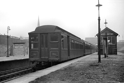 Mersey Railway EMU, with car no. 32 leading, at Birkenhead Park station on 19/10/1946. These Birkenhead electrics had American designed bodies with matchboard sides and clerestory roofs built by G. F. Milnes & Co. at Hadley in Shropshire. The traction equipment came from Westinghouse in Preston whilst the equalised bogies were built by Baldwin in the USA and delivered as the finished articles. This leading coach is a Motor Third and was built in 1903. Nearly all these American style units were withdrawn in 1956 with just a couple surviving into 1957. Sadly, none was saved for our enjoyment. [H. C. Casserley / Mike Morant collection]