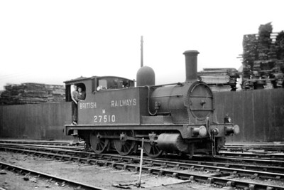 Former North London Railway, JC Parks designed 0-6-0T no. M27510 at Devons Road mpd on 24/8/49. No. 27510 had been built at the NLR's own Bow works and entered service in June 1879. It's interesting to note that it is BR branded in this shot but its allotted number, 58862, wouldn't be applied until August 1950. Withdrawal came at Devons Road (Bow) mpd in June 1955. [Mike Morant collection]