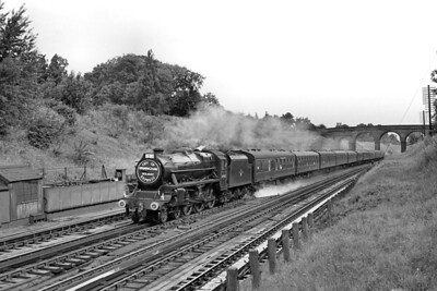 Aston allocated, Stanier 'Black 5' 4-6-0 no. 44942, with a headboard proclaiming City of Birmingham Holiday Express, takes on water on the Up fast lines at Bushey troughs on 3/8/62. [Mike Morant collection]