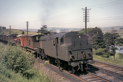 Fairburn 4MT 2-6-4T no. 42110 performing in its usual role as a banking engine depicted here departing northwards from Tebay on 29/6/65. 42110 was a Tebay 'banker' from February 1963 until withdrawal in June 1966. [Mike Morant collection]