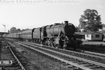 The less than common sight of a Stanier 8F in charge of passenger stock. This is Staveley Barrow Hill allocated no. 48407 at Mill Hill on 27/5/60 but it isn't quite as exciting as one might hope as the headcode indicates that this is merely an ecs working. [Mike Morant collection]