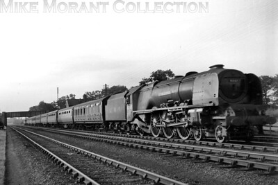 LMSR,Stanier unfrocked 'Coronation' pacific no. 6247 City of Liverpool in charge of a Perth - Euston express at Cathiron on 27/7/1947. This was originally one of the streamlined Coronations and its shroud had been removed only a month before this shot, in wartime plain black livery and Camden shed allocated, was taken. [Mike Morant collection]