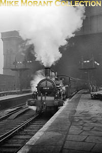 LMSR Kirtley designed outside framed 0-4-4T no. 1211 at St. Pancras station in January 1935. 1211 was built by Dübs & Co, with works Number 362 and entered Midland Railway service in 1870 as fleet no. 785 but was renumbered in 1907 as shown here. This shot was taken only a short time before 1211 was withdrawn in May 1935. [S. H. Freese / Mike Morant collection]