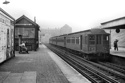 Mersey Railway EMU, with car no. 9 leading, at Birkenhead Park station on 19/10/1946. These Birkenhead electrics had American designed bodies with matchboard sides and clerestory roofs built by G. F. Milnes & Co. at Hadley in Shropshire. The traction equipment came from Westinghouse in Preston whilst the equalised bogies were built by Baldwin in the USA and delivered as the finished articles. This leading coach is a Motor First and was built in 1903. Nearly all these American style units were withdrawn in 1956 with just a couple surviving into 1957. Sadly, none was saved for our enjoyment [H. C. Casserley / Mike Morant collection]