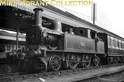 """LNWR Webb 4' 6"""" 2-4-2T no. 663 waits at New Croydon station whilst operating the timetabled service to Willesden Junction of which there were five round trips per day. No. 663 was built at Crewe in February 1890 with works no.  3076 and had condensing gear fitted from new. Withdrawal came for no. 663 in August 1925. [Mike Morant collection]"""