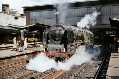 Green liveried, Stanier 'Coronation' pacific no. 46252 City of Leicester at Carlisle Citadel station on 20/5/61. 46252 had only recently moved from Upperby to 12A Kingmoor when this shot was taken but would end her days of service in June 1963 whist  allocated to Camden mpd. [Mike Morant collection]