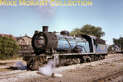 """When the Randfontein Estates Gold Mining Company resumed full-scale operations in the early 1970s, it was necessary to replace its original tank locomotives with more suitable motive power for the extended mainline being built to serve the new shafts. REGM 4-8-2 No. 5 was seen soon after arrival at the mine in 1980. The ex-SAR 14R class locomotive No. 1730 had been built as a class 14 by Robert Stephenson & Co. [under works no. 3614/1914] and later reboilered. [A.E. """"Dusty"""" Durrant / Mike Morant collection]"""