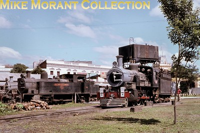 A general view of the standard gauge loco yard behind Asunción station (Paraguay) in March 1980 included F.C. Presidente C.A. Lopez 2-6-2T locomotive No. 6 and FCN Urquiza (ex Entre Rios, Argentina) 4-6-0 No. 222.  [Note the hinged front buffers, folded back to avoid locking in sharp curves.] Part of the ornate station building can be seen beyond the water tower. [A. E. 'Dusty' Durrant / Mike Morant collection]