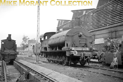 Pre-partition Indian steam locomotive. Great Indian Peninsula Railway W41 class broad gauge 0-8-0ST no. 0208 on shed. No. 0208 had been built by Kitson with works no. 3775 in 1898. The loco on the left is GIPR X46 Class 0-6-2T (later X1) N° 93. By this stage these locos were classified X1 and W3. [Mike Morant collection]