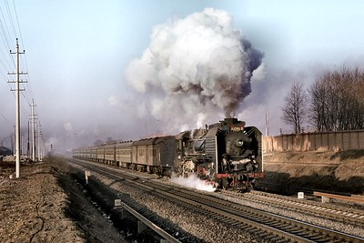 Chinese State Railway RM class pacific no. 1091, a Sifang works product, puts on a good show for the photographers at Changchun on 2/4/86. The photographer has noted that it was 6.34 a.m. and that the air temperature was minus 20˚C but it was worth the early start. [Martin Robinson / Mike Morant collection]