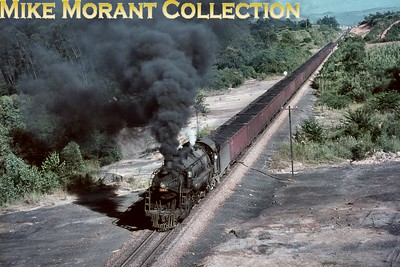 """Brazil, RFFSA (Teresa Cristina Division) metre-gauge 2-10-4 No. 308 heads a fully loaded coal train in 1977. These powerful """"Texas"""" type locomotives had been built in 1940 by both the ALCO and Baldwin Locomotive works for the E.F. Central do Brasil. [Mike Morant collection]"""