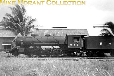 Malayan rfailways (KTM) American built USATC 2-8-2 at Singapore in 1947. There is no number evident but note that the engine has British WD markings. [Mike Morant collection]