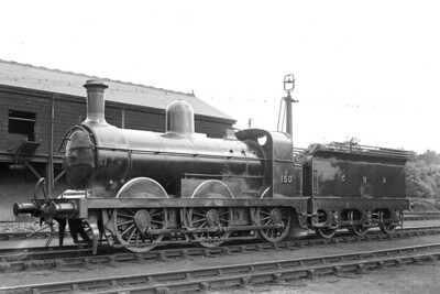 """A circa 1920 view of GNR, James Stirling designed J4 class 0-6-0 no. 150 at the unlikely location of the LSWR's shed at Strawberry Hill. No. 150 entered GNR service in August 1888 but was subsequently rebuilt with a domed boiler under Gresley's auspices. The """"A"""" prefix to the number indicates that this loco was consigned to the duplicates list in May 1906. Following the 1923 grouping, the LNER applied the number 3150 in July 1925 and withdrawal came in May 1929. [Mike Morant collection]"""