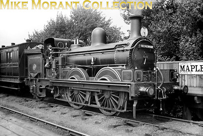 SECR 0-4-2 radial well tank no. 558 in charge of a service bound for Beckenham (Junction) at Dulwich station in 1904. No. 558 was a Kirtley design for the LCDR built by Neilson in 1873 and was originally numbered 99. Nomenclature of the day for this class was Large Scotchmen apparently. The depicted location, Dulwich, was renamed West Dulwich by the Southern Railway on 20/9/1926. [Mike Morant collection]