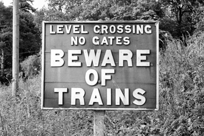 A warning sign before the ungated crossing at Petrockstow station on the North Devon & Cornwall Junction Light Railway.I suspect that this sign dates from the days when the line was owned by Col. Stephens hence no indication of railway ownership. [Mike Morant collection]