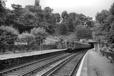 Upper Sydenham on the Crystal Palace (High Level) branch taken on 13/7/54 exactly a week before the branch's closure. This view is looking north towards the Crescent Wood tunnel mouth and includes 4-SUB no. 4678 displaying the 57 headcode although, in fact, this is the rear of the train. [H. C. Casserley / Mike Morant collection]