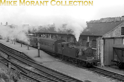Former LSWR Drummond M7 class 0-4-4T no. 30111 awaits departure time for the 13.33 Swanage to Wareham service on a murky 11/7/62. No. 30111 was a Bournemouth allocated engine from nationalisation until withdrawal in January 1964.  [Mike Morant collection]