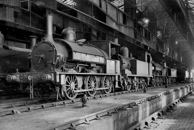 Inside Nine Elms shed on 10/4/1920 is an interesting line-up of LSWR motive power with '330' class 'Beyer' 0-6-0ST no. 150 to the fore followed by a G6, another '330' and an O2. No. 150 had been built by Beyer Peacock in May 1882 and would be withdrawn by the Southern Railway in May 1929. [H. C. Casserley / Mike Morant collection]