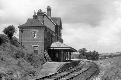 Lavant station, the first station north of Chichester on the line to Midhurst, taken from the trackside on 17/7/58. Lavant had opened in 1881 but closed to passenger traffic on July 8th, 1935. However, goods operations continued until 1968 but one railtour brought passengers to this station, The Hayling Farewell tour on 3/11/63.  The building shown here is extant and in private ownership. [H. C. Casserley / Mike Morant collection]