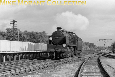 Hither Green allocated Maunsell N1 class mogul no. 31876 running light bustles through Hildenborough station on 13/9/57. According to my headcodes book this discs combination is for the route from Holborn to ramsgate via Nunhead, Chislehurst and Chatham. 31876 would move to Tonbridge shed in March 1959 and then to Stewarts Lane in June 1962 followed by withdrawal in the following November. Another loss in The Great Cull of 1962. [Mike Morant collection]