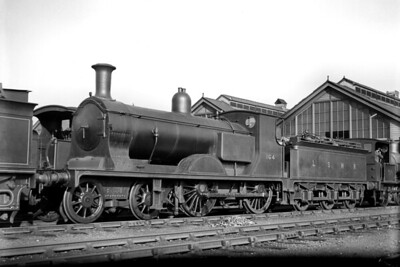 LSWR, Drummond L11 'mixed traffic' 4-4-0 no. 164 at Eastleigh shed on 17/4/1922. No. 164 had been built at the company's Nine Elms works in October 1903 and would be withdrawn as BR no. 30164 in lined black livery at Feltham mpd in September 1951. [H. C. Casserley / Mike Morant collection]