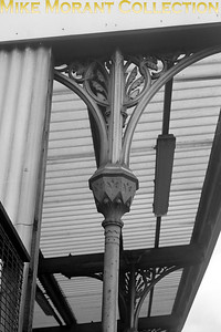 An undated view of an ornamental stanchion at East Brixton station on the SLL (South London Line) netgween Victoria and London bridge via Peckham Rye. Opened as Loughborough Park station by the LBSCR on 13/8/1866, East Brixton was renamed Loughborough Park and Brixton on 1/1/1870 but was renamed again to East Brixton on 1/1/1894. The station was closed by BRB on 5/1/7976. [Mike Morant collection]