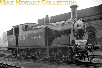 Former LSWR Drummond designed M7 class 0-4-4T no. 30241 is depicted here at its home shed of Nine Elms on 19/10/48 only three months after the malachite livery and BR number had been applied. 30241 would remain at Nine Elms until October 1962 and would be withdrawn at Eastleigh mpd in July 1963. [Mike Morant collection]