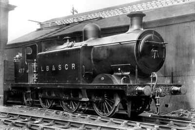 RJ Billinton E4X class 0-6-2T no. 477 rests between duties at New Cross shed, its home at the time, on 9/4/1921. No. 477 was built as an E4 at the LBSCR's Brighton works in October 1898 and enhanced to the E4X specification in 1911 as the last of four to be thus modified. Despite being non-standard it saw out more than sixty years of service and was withdrawn as BR no. 32477 at 75C Norwood Junction mpd in January 1959. [H. C. Casserley / Mike Morant collection]