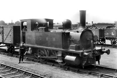 LSWR, Adams B4 class 0-4-0 dock tank no. 94 poses with its crew at Eastleigh on 28/5/1921. No. 94 was built at the company's Nine Elms workshops and had entered traffic in December 1892. It was one of the few of this class that didn't have a name applied and it was also relatively long lasting being withdrawn in March 1957 whilst allocated to Plymouth Friary mpd. [H. C. Casserley / Mike Morant collection]