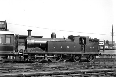 LSWR, Drummond designed M7 class 0-4-4T no. 320 on ecs duty in in Clapham Junction's carriage sidings on 29/4/1922. 320 was built at Nine Elms works in September 1900 and would be withdrawn as BR no. 30320 in May 1963. [H. C. Casserley / Mike Morant collection]