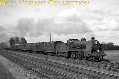 Southern Railway, Maunsell 'U' class mogul no. 1805 with an interesting rake of LSWR coaches at Hook on 21/8 /1938. I'm puzzled by the headcode though. [J. H. Venn / Mike Morant collection]