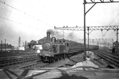 A sli9ghtly soft image of LBSCR, Stroudley D1 class 0-4-2T no. 283 on the Down Fast line at Clapham Junction on 28/2/1920. [H. C. Casserley / Mike Morant collection]