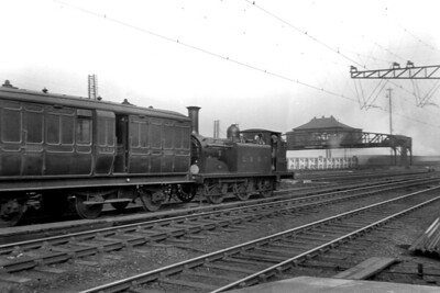 LBSCR, Stroudley D1 class 0-4-2T no. 222 on ecs duty at Clapham Junction on 28/2/1920. [H. C. Casserley / Mike Morant collection]