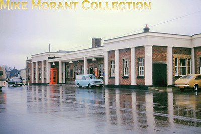 The colonnaded facade of the original Dorchester South station on a very wet 14/4/75. There is a note on the slide mount which tells us that the adjacent platform was still in use. [Mike Morant collection]