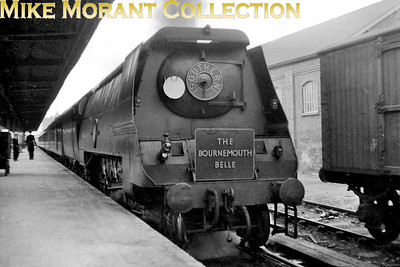 Southern Railway, malachite liveried Bulleid original 'Merchant navy' pacific no. 21C14 Nederland Line in charge of the Bournemouth Belle at Bournemouth West station. Th Belle had been reinstated on 7/10/1947 whilst 21C14 would be BR branded in May 1949. The short rake of Pullman cars suggests that this was taken on a Sunday. [Mike Morant collection]