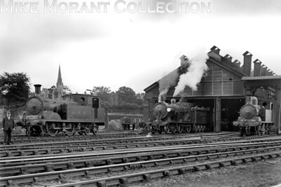 The embodiment of a Fat Controller keeps an eye on the photographer's efforts in this splendid panoramic view of Basingstoke shed taken on 7/7/1926. The loco on the left appears to be Adams T1 class 0-4-4T no. 10, the spotless Drummond 'Greyhound' T9 4-4-0 is no. 721 but the 0-4-4T on the right isn't identifiable but appears to be an O2 class 0-4-4T. [Mike Morant collection]