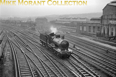 Former GWR 'Dukedog' double-framed 4-4-0 no. 9017 arriving at the unlikely location of Brighton on the Southern Region on 15/2/1962. 9017 had been withdrawn from BR service at (89C) Aberystwyth mpd in October 1960 and was then moved to and stored at Oswestry until sale to the heritage Bluebell Railway in January 1962. GWR locos were banned from running on former LBSCR metals and special dispensation was given for this unique journey. [Mike Morant collection]