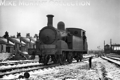 Snow covered Plymouth Friary shed hosts Adams T1 class 0-4-4T no. 14 on 27/12/1927. [H. C. Casserley / Mike Morant collection]