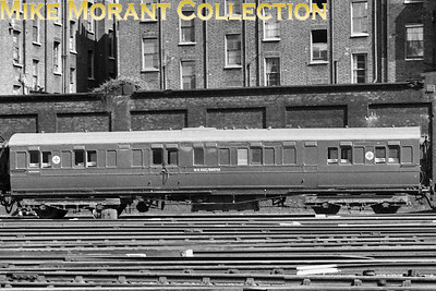 Spotless LSWR ambulance coach no. W.D. RXC/000753 at London's Victoria station in July 1957. [Mike Morant collection]